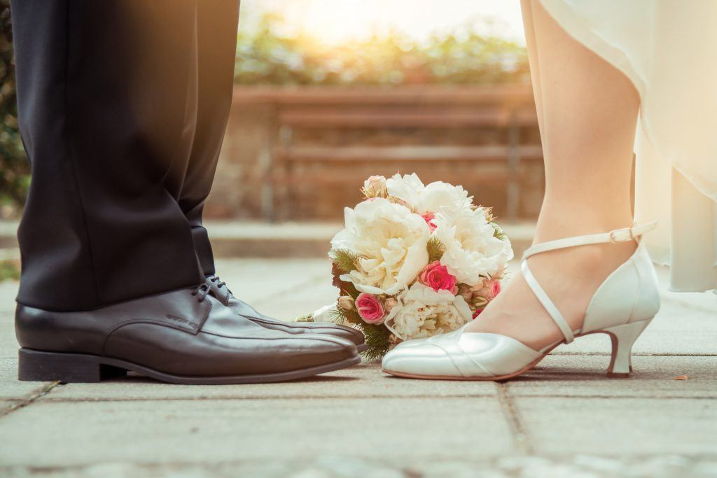 Brige and groom`s Wedding shoes with bunch